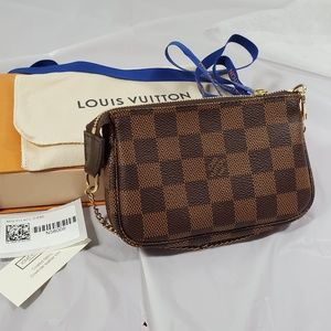 Brand New authentic Louis Vuitton mini pochette